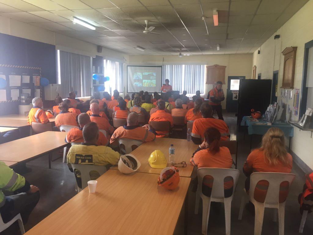 group of workers listening to toolbox talk